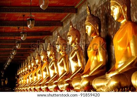 Gold statue group Buddha and lamp at Wat Rachanutda in Bangkok,Thailand - stock photo