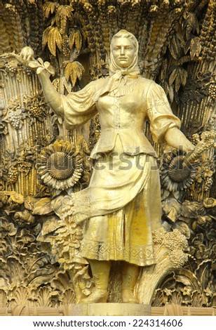 gold statue of the girl in a national suit