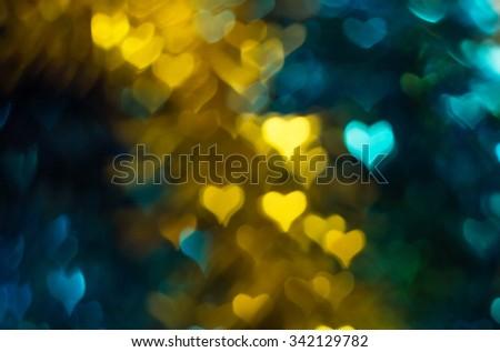 Gold stripe, blue heart bokeh celebration background - stock photo