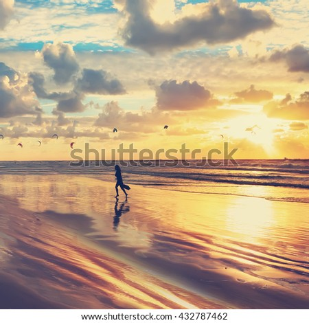 Gold sunset of Mediterranean. Sand beach view and kite surfing. Toned colors vintage photo - stock photo