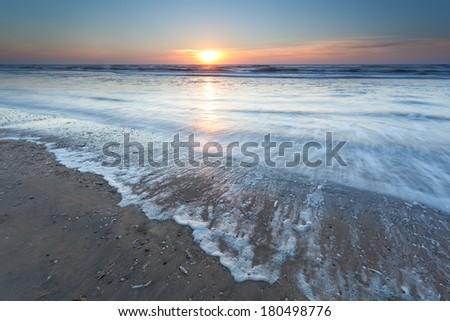 gold sunset over North sea beach, Zandvoort aan Zee, North Holland, Netherlands - stock photo