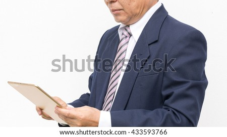 gold  tablet on screen in the hand on white  background