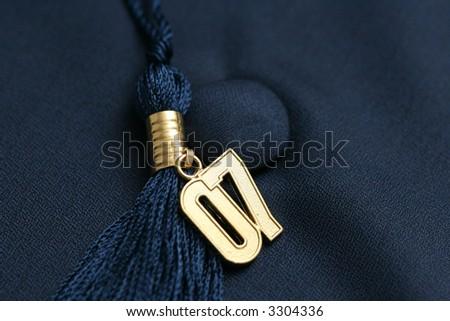Gold '07 tassel on background of blue graduation cap - stock photo