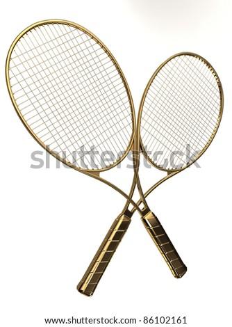 Gold tennis rackets. - stock photo