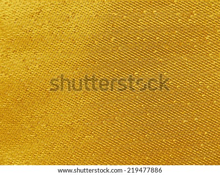 Gold thread on the fabric - stock photo