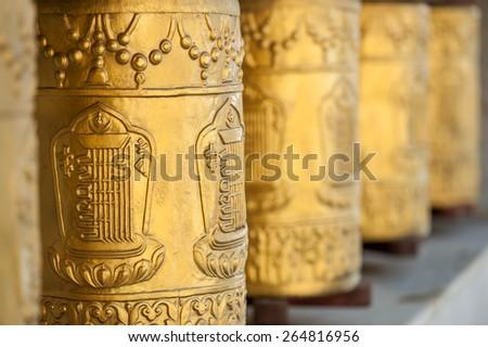 gold tibetan spool in himalayas - stock photo