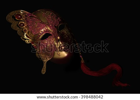 Gold tone Venecian carnival Mask black background - stock photo