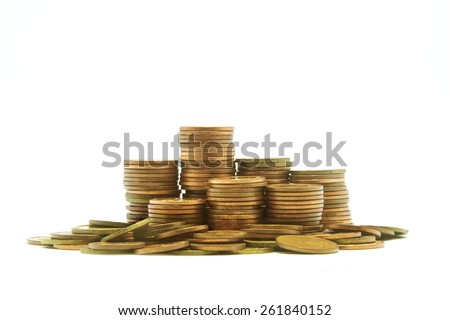 Gold towers made out of gold coins on the whit background - stock photo