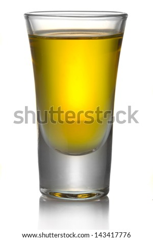 Gold transparent tequila shot isolated on white background