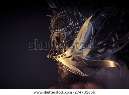 Gold, Treasure, jewels and silver. Man with mask of precious metals - stock photo