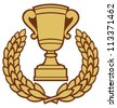 gold trophy cup and laurel wreath - stock photo