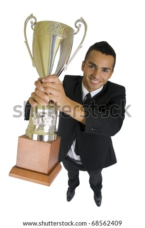 Gold trophy in the hands of a smiling business man, wide angle, isolated. - stock photo