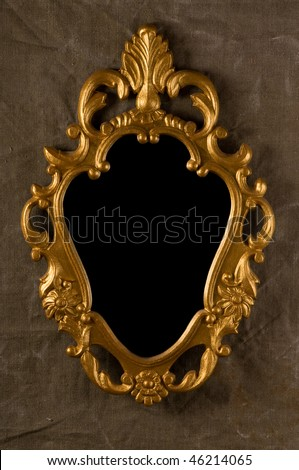 gold vintage frame on fabric wall