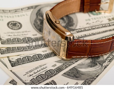 gold watches are on dollar bills - stock photo