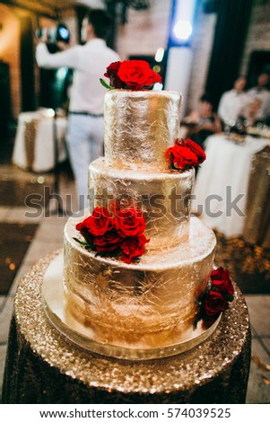 red and gold wedding cake pictures gold wedding cake roses stock photo 574039525 19079