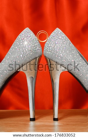 gold wedding rings and shoes  - stock photo