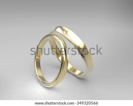 Gold wedding rings. 3d render on a light background