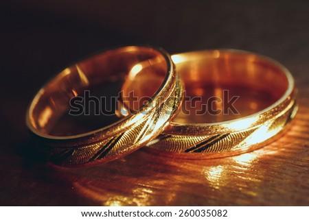 gold wedding rings in nice lite  - stock photo