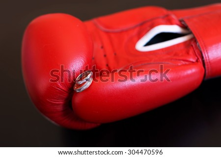 Gold Wedding Rings on Red Boxing Glove