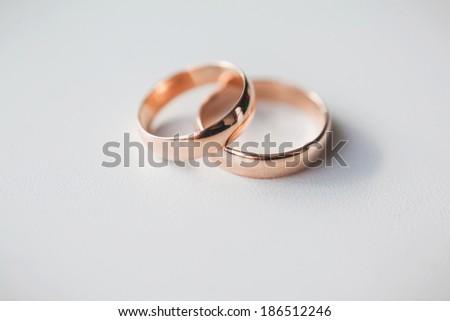 gold wedding rings on white - stock photo