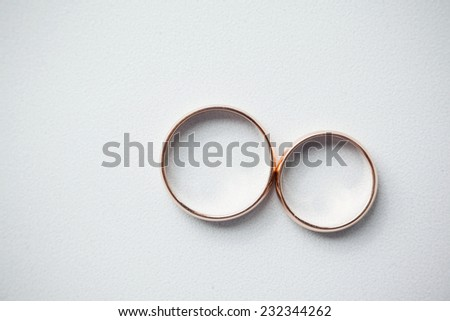 gold wedding rings on white