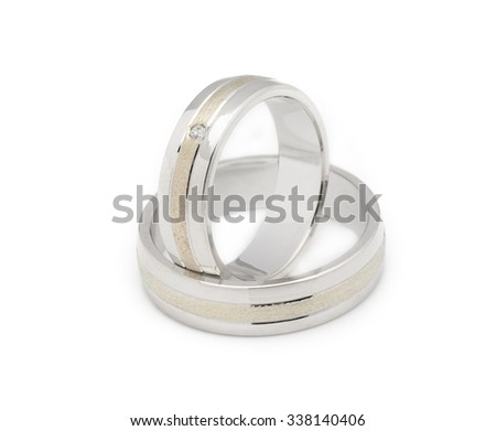 Gold wedding rings with diamonds isolated on white background