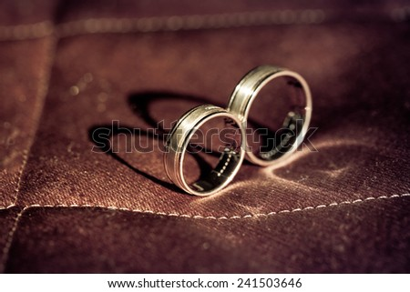 Gold wedding rings with precious stones - stock photo