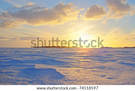 Gold Winter Frozen Sea Sunset in Finland - stock photo