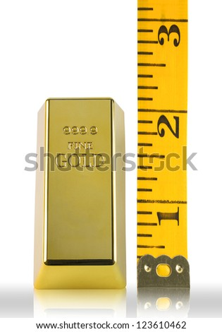 Gold with tape measuring - stock photo