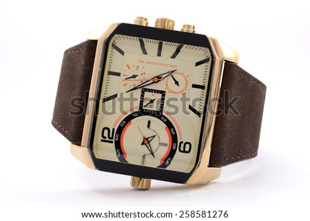 gold wristwatch on a white background - stock photo