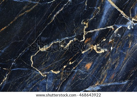 Gold, yellow and white patterned natural of dark gray marble texture.