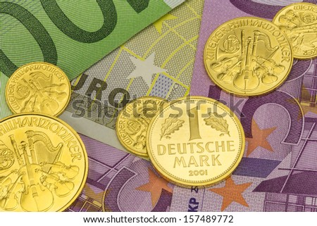 Goldcoins with eurobanknotes  - stock photo