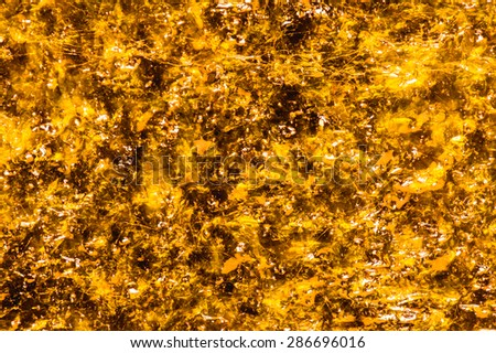 Golden abstract background texture. - stock photo