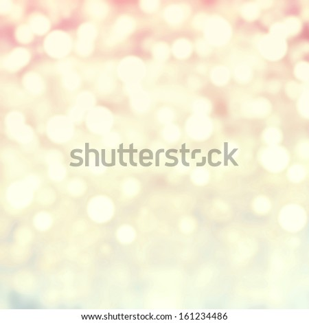 Golden Abstract Christmas background with glowing magic bokeh and snow flakes, defocused holiday lights with copyspace  - stock photo