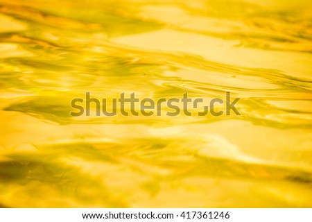 Golden abstract water background - stock photo