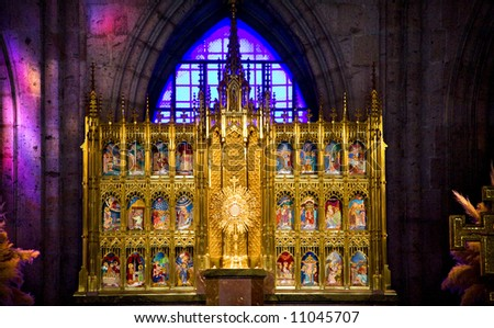 Golden Altar with Biblical Stories, Blue Stained Glass Background, Temple of Atonement, Templo Expiatorio, Guadalajara, Mexico - stock photo
