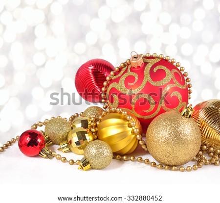 Golden and red Christmas decorations on a bokeh background