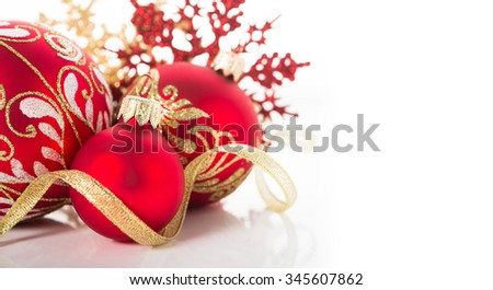 Golden and red christmas ornaments on white background. Merry christmas card. Winter holidays. Xmas theme. Space for text. - stock photo