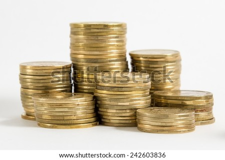 Golden and silver coins isolated on white background - stock photo