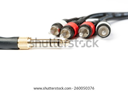 golden and silver jack plug isolated on white ground - stock photo