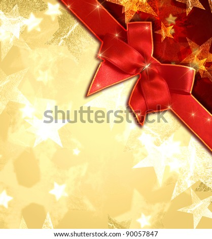 golden and white stars over beige and red background with red ribbon