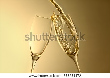 golden aniversary or new year champagne splash background