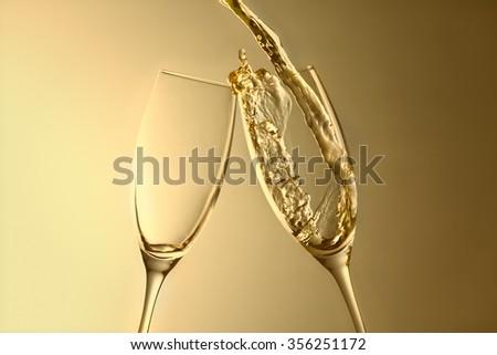 golden aniversary or new year champagne splash background - stock photo