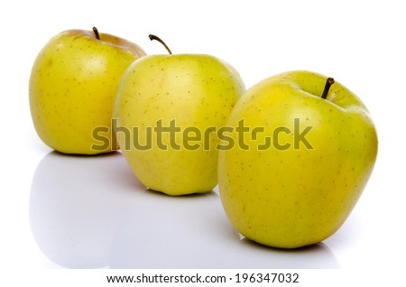 Golden apples, isolated on white - stock photo