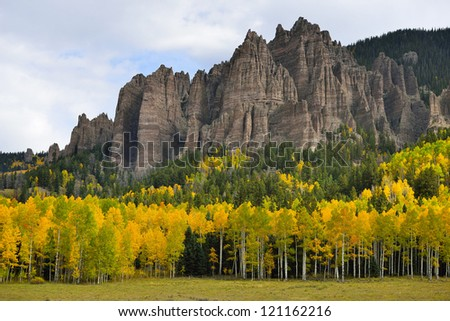 golden aspen in Pinnacles of High Mesa adjacent to Silver Jack Reservoir in Colorado - stock photo