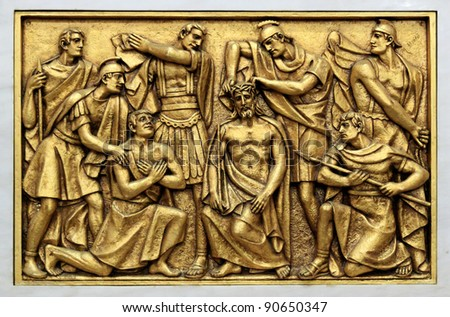 Golden bas-relief of the old Basilica of Fatima representing one of the fourteen mysteries of the rosary, similar to the stations of the cross. This bas-relief depicts Jesus crown of thorns. - stock photo