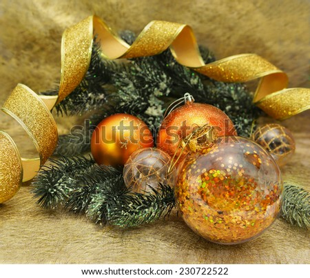 Golden baubles with green conifer branches and curved yellow ribbon, Christmas and New year still life - stock photo