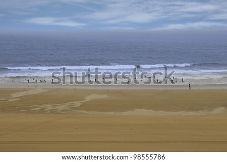 golden beach with children getting ready to be taught surfing in ballybunion county Kerry Ireland - stock photo