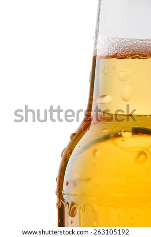 Golden Beer in a Beer Bottle with Water Droplets - stock photo