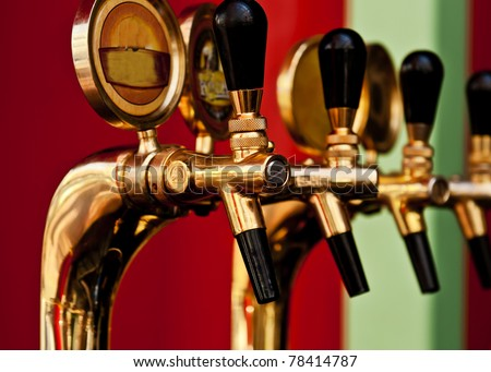 golden beer tap - stock photo